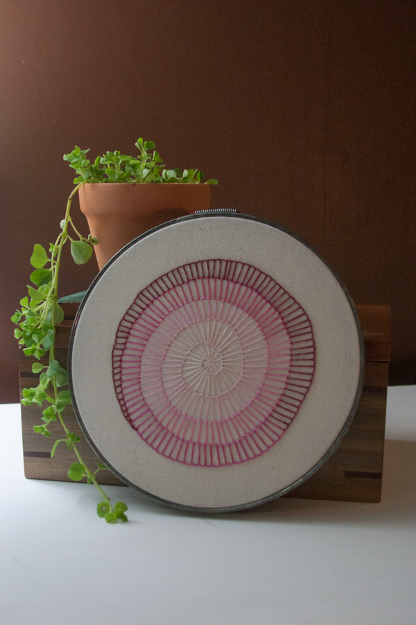pink spiral finished embroidery